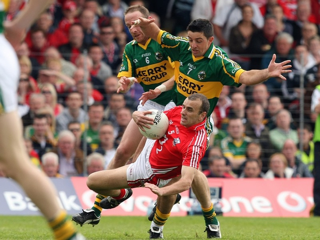 Cork's John Miskella retains possession despite the attentions of Kerry's Tommy Griffin Aidan O'Mahony