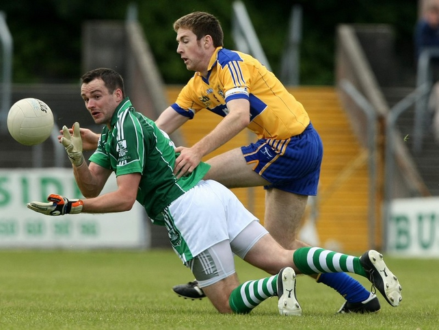 Limerick's Jim O'Donovan and Clare's Kevin Dileen in action in Ennis today