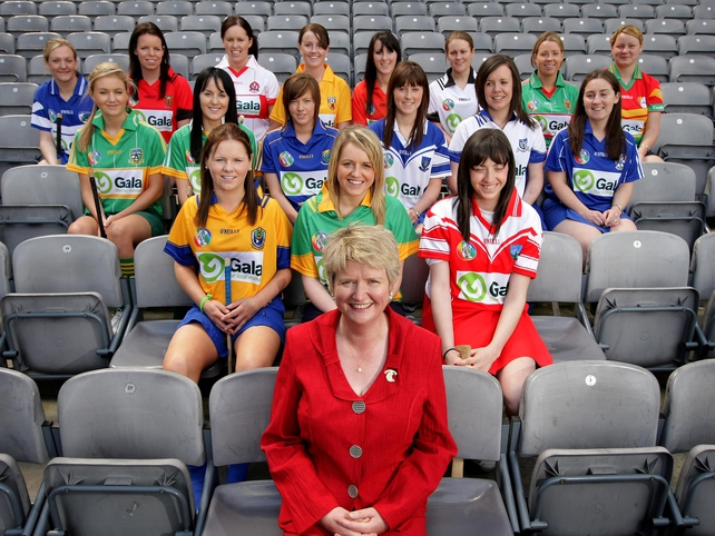 President Joan O'Flynn is pictured with some of the players who will be particpating in the various championships