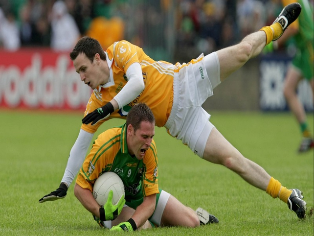 Donegal's Neil Gallagher Antrim's Niall McKeever battle for possession in Ballybofey
