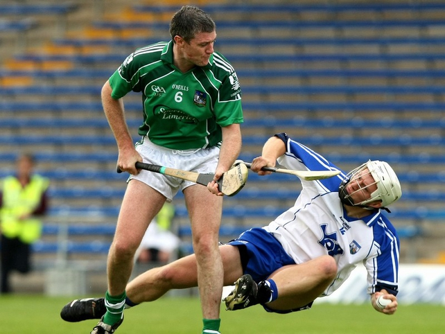 Stephen Molumphy (r) of Waterford feels the full force of Limerick's Brian Geary