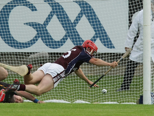 Galway's Niall Healy goes to ground before going on to score his side's third goal