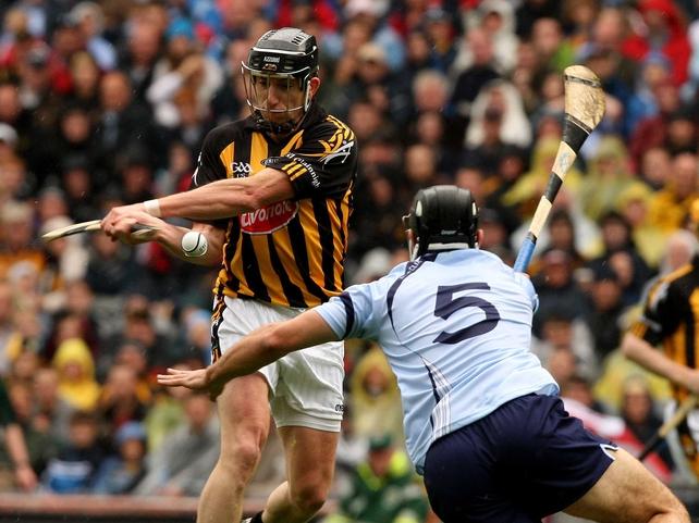 Dublin's Stephen Hiney attempts to block Derek Lyng of Kilkenny