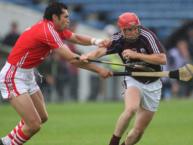 Cork's Sean og o hAilpin and Niall healy of Galway tussle for possession