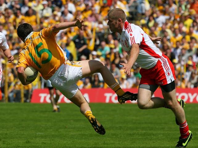 Antrim's Tomas McCann & Tyrone's Kevin Hughes go head to head