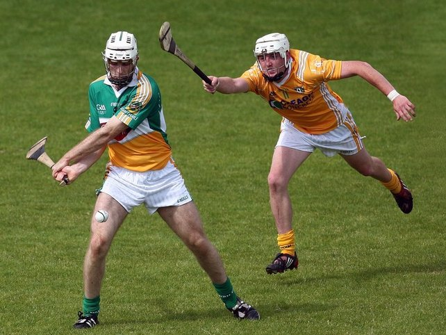 Offaly goalscorer Kevin Brady is challenged by Karl McKeegan of Antrim