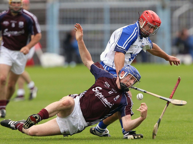 Galway's Cyril Donnellan and Waterford's Seamus Prendergast battle for possession in Tom Semple's field