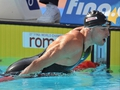 Phelps sets new record in 200m win