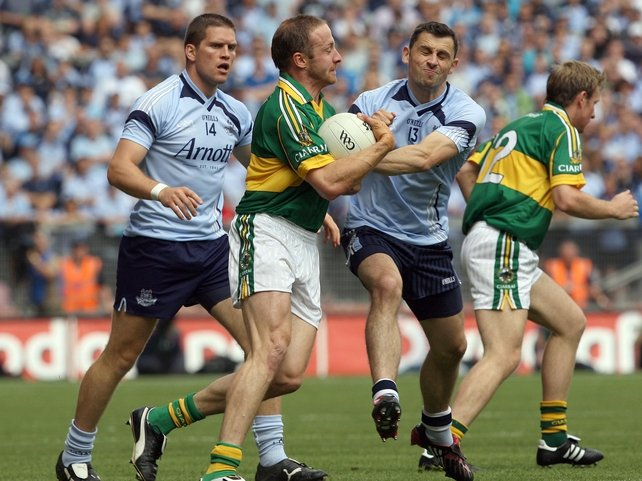 Tommy Griffin and Bernard Brogan battle for possession in this afternoon's quarter-final
