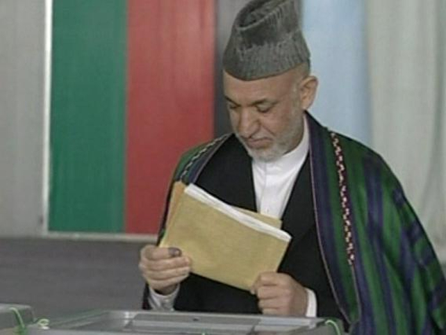 Hamid Karzai - Cast his vote early this morning