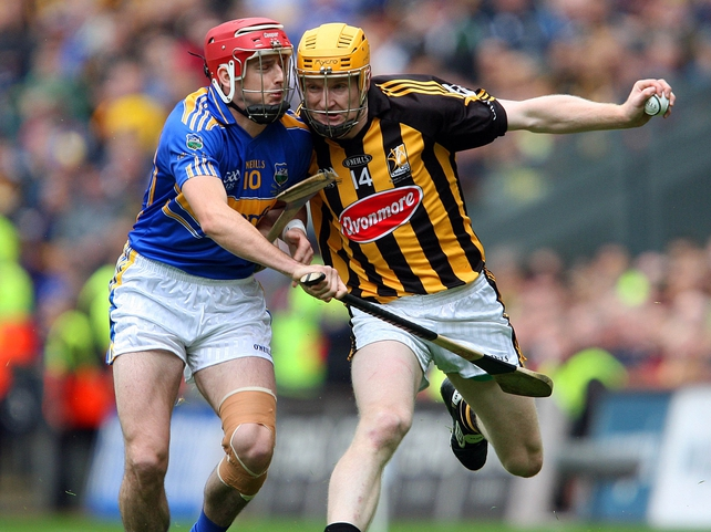 Kilkenny's Richie Power and Tipperary's Pat Kerwick giving it all in this superb hurling final