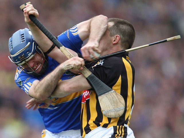 GIVE ME THE BALL! Tipperary's Eoin Kelly and Kilkenny's Michael Kavanagh locked in combat