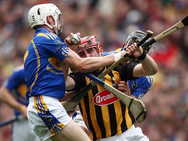 Tipperay's Brendan Maher tries to get to grips with Kilkenny's Eoin Larkin