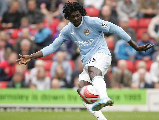Emmanuel Adebayor's team bus has been shot at in Angola ahead of the African Cup of Nations