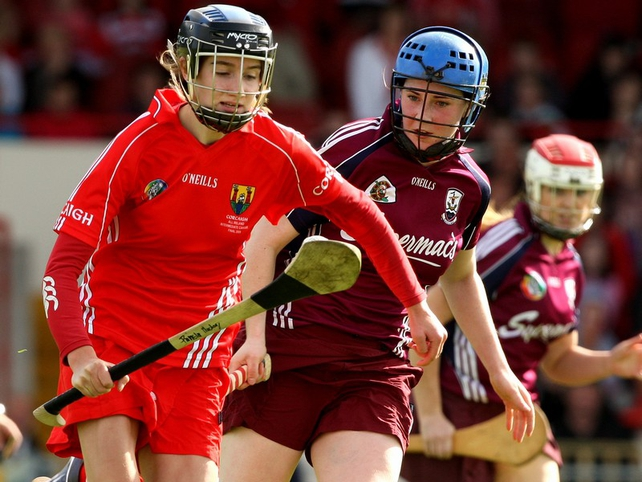 Pamela Mackey of Cork and Galway's Paula Kenny battle for possession