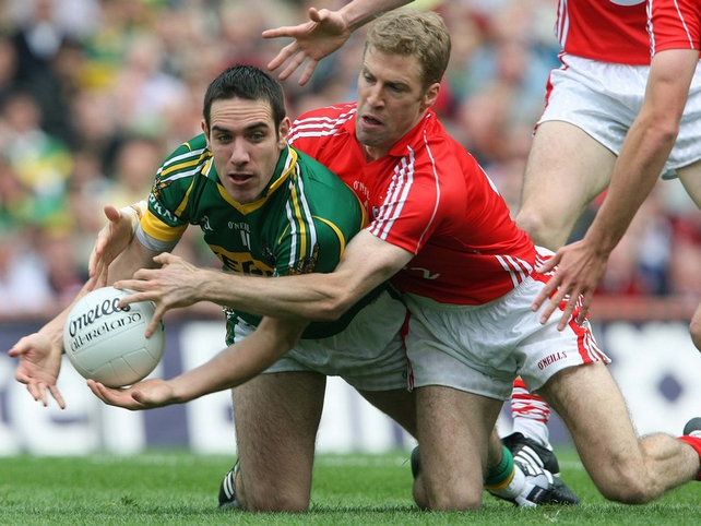 Kerry's Declan O'Sullivan is challenged by Cork's Anthony Lynch