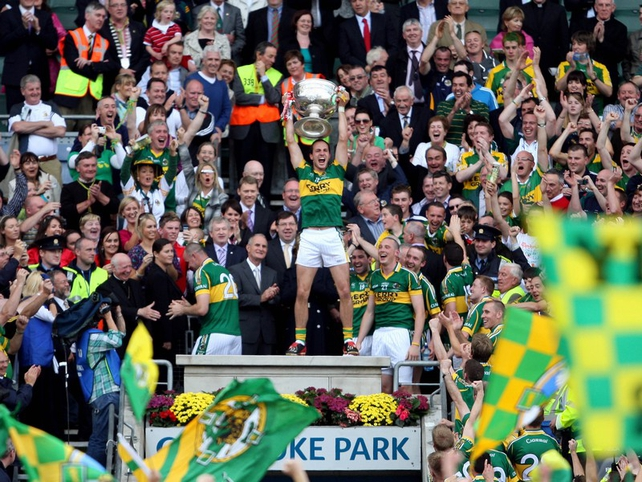 Tadhg Kennelly raises aloft the Sam Maguire Cup and also treated the crowd to a jig, reminiscent of his Grand Final celebrations for Sydney Swans in 2005