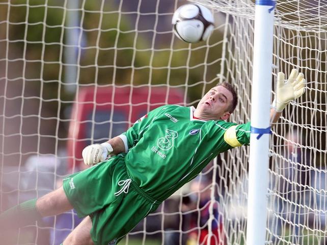 Waterford 'keeper Michael Devine is helpless as Brennan's eighth-minute free-kick flies into the top corner