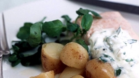 Salmon in a Cheese and White Wine Sauce, with Cheese and Onion Potatoes and Side Salad - A hearty, comforting meal for one.
