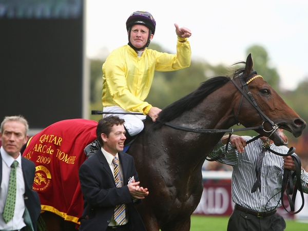 Mick Kinane aboard Sea The Stars after their triumph at Longchamp