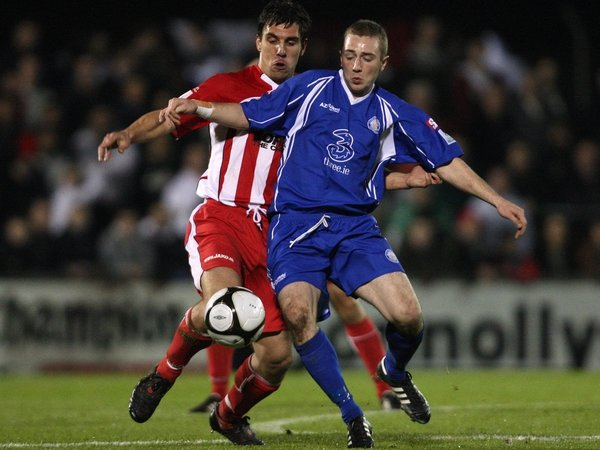 Sligo Rovers' Gavin Peers and David Grincell of Waterford United battle for possession at The Showgrounds