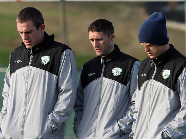 A sad sight: Richard Dunne, Robbie Keane and Damien Duff at training in Malahide this morning