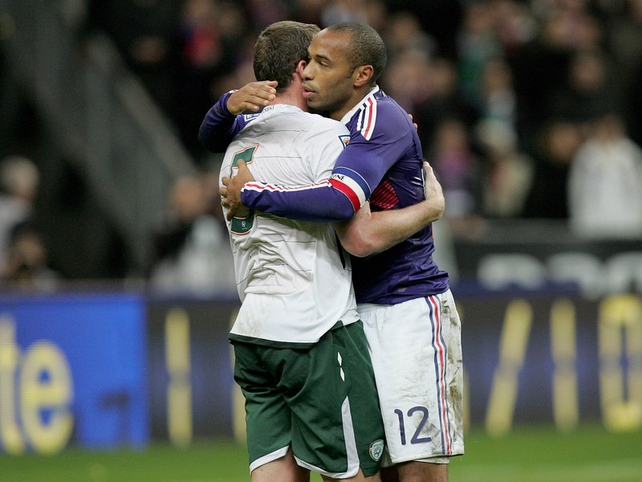 Richard Dunne is embraced by Thierry Henry after Ireland's controversial defeat in Paris
