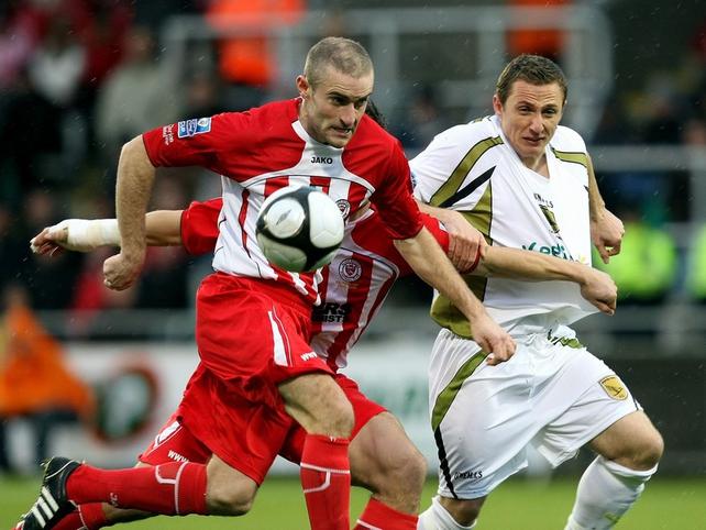 Sligo Rovers' Alan Keane and match-winner Gary O'Neill of Sporting Fingal