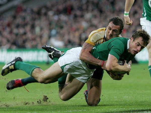 Quade Cooper can't prevent Tommy Bowe scoring a try during the recent draw at Croke Park