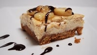 Banana and Caramel Cheesecake with a Warm Chocolate Sauce - Simon Delaney serves up this delicious cheesecake.