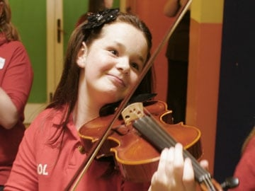 Kayleigh Greenhalgh on Violin, 6th Class, St Agnes