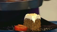 Ginger Cake with Orange Praline Frosting and Plums Roasted with Orange Liqueur