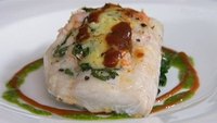 Gratin of Hake, Prawns and Basil on a Bed of Spinach - In Neven Maguire's dish the flavour contrasts beautifully with the fish.