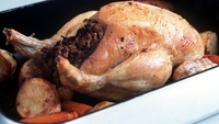 Roast Chicken with Mushroom and Courgette Stuffing - A stuffed chicken served with red onion gravy.