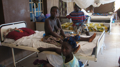 Women relax after giving birth in Kenema hospital.