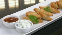 Lamb samosas with raita - A delicious crispy samosa served with a mint yoghurt dip.