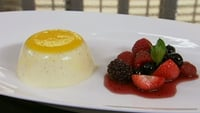 Passion Fruit Panna Cotta - Served with Poached Autumn Berries. Panna cotta is a set Italian cream that is a cross between a mousse and a crème brûlée (but without the crunchy topping). What makes this version a little different is the addition of coconut milk, which gives them a truly exotic flavour.