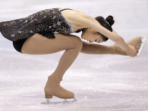 Kim Yu-Na took ladies' figure skating gold
