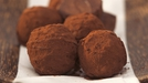 Petit Fours – Bitter Chocolate Truffles - You don't have to use only a tart base for the mix; you could use a sponge.