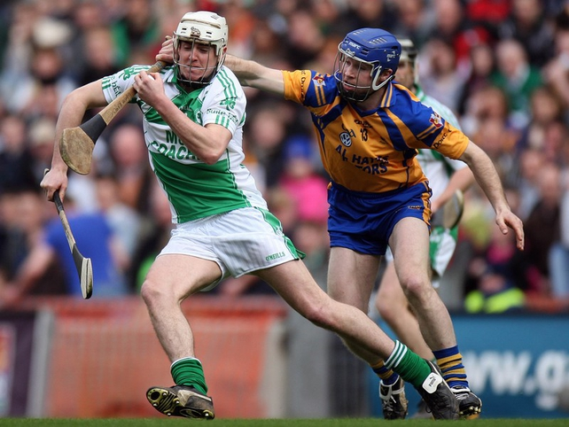 Alan Cuddihy of Ballyhale gets away from Portumna's Damien Hayes