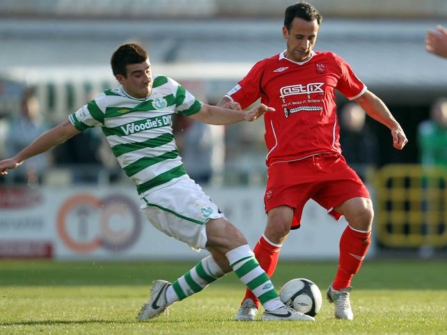 Shamrock Rovers' Robert Bayly challenges Dundalk's goalscorer Neale Fenn