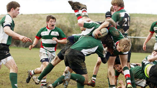 Should tackling be banned in schools rugby?