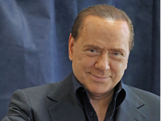 Silvio Berlusconi - New law gives him temporary immunity