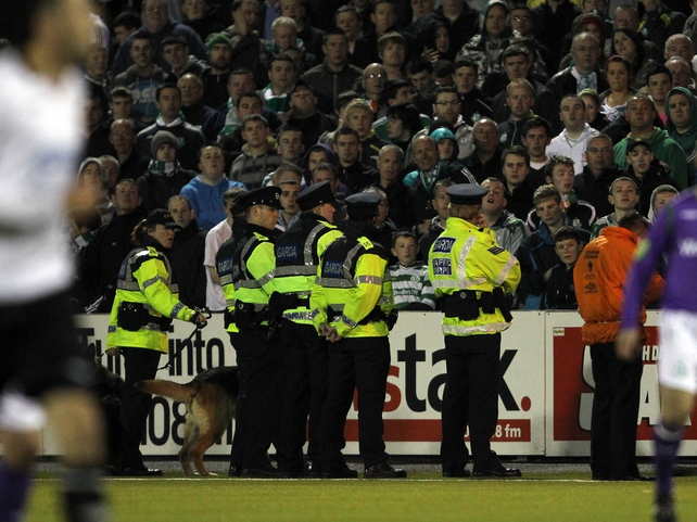 Gardaí confronted fans as they threw bottles and wood onto the pitch