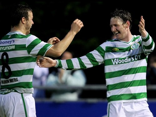 Gary Twigg celebrates his late winner for the Hoops with fellow goalscorer James Chambers
