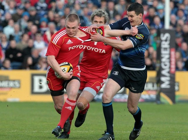 Keith Earls and Jonathan Sexton in action at the RDS
