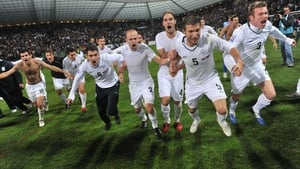 Slovenia's players in jubilant mood after their play-off victory over Russia