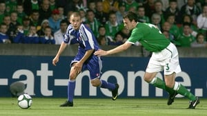 Slovakia's Vladimir Weiss gets past Northern Ireland's Jonathan Evans in a World Cup qualifying clash at Windsor Park