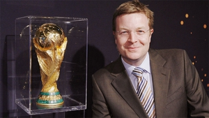 Darragh Maloney and the World Cup Trophy.