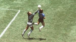 Maradona and his arm rise above Peter Shilton